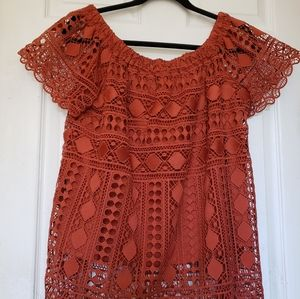 Maurice's rust coloured blouse